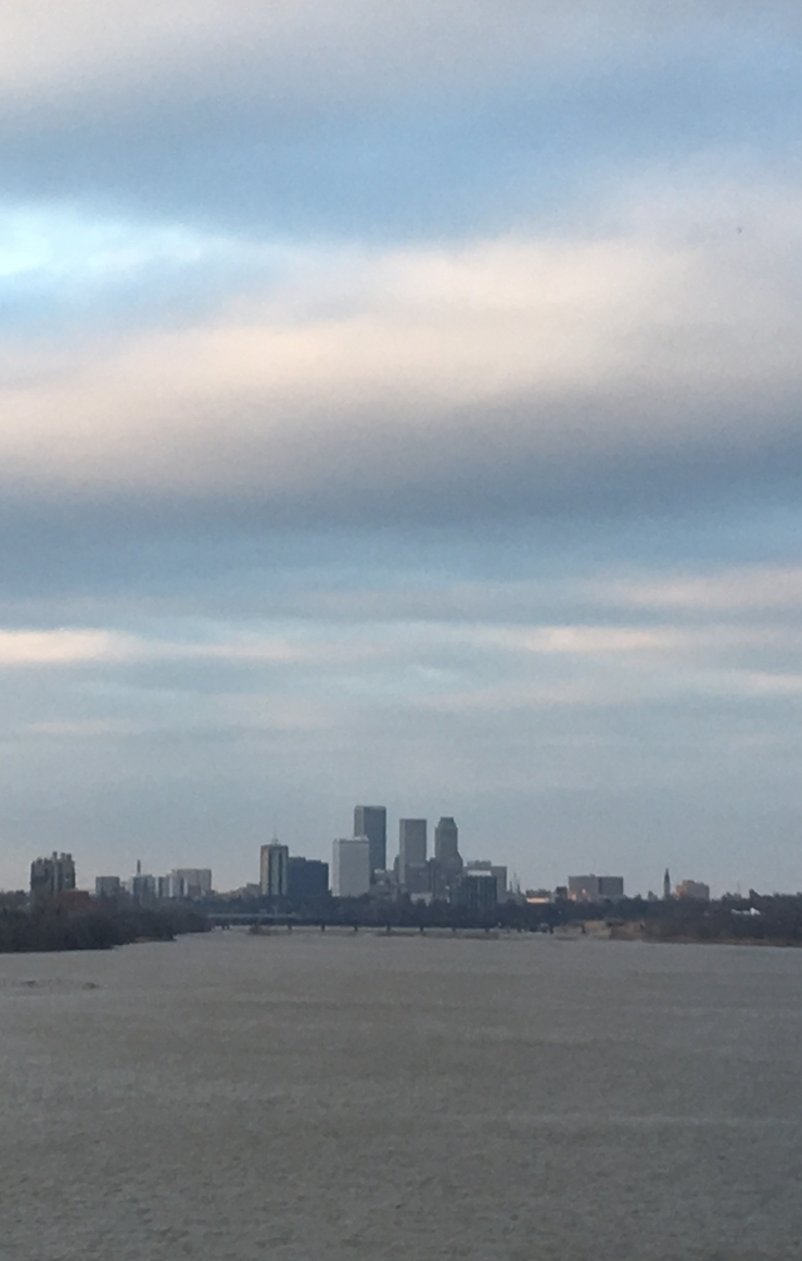 [Tulsa skyline with Arkansas River in front]